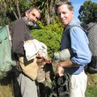 Te Araroa Trail Otago trustee Gilbert van Reenen (left) weighed down by  his 1960s tramping kit,...