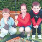 Te Tipua School vegetable gardeners (from left) Lucas Dickison (7), Briana Miller (8) and Ashley...