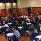 Teams competing in the Extra! spelling quiz held in Timaru last night listen to instructions...