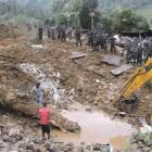 Teams engage in rescue operation work at the site of a landslide at the Koslanda tea plantation...
