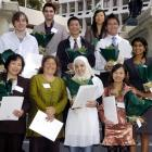 Ten of the 11 people who became New Zealand citizens this week are: (front, from left) Hop Thi...