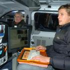 StreetCam driver Dave Morris (left) and technician Julian Read, both of Wellington, take a break...