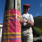 Teviot Valley Scottish Week organising committee member Ken Bain checks the festive sleeves on...
