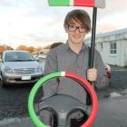 Thani  McLaren  shows the prototype of his  device to help foreign drivers keep left on New...