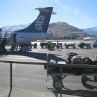 The baggage handlers and airport crew, pictured here servicing an Air New Zealand Link ATR-72,...