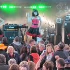 The Beat Girls warm up the crowd during the Bog Rocks Music Festival at Whitestone Contracting...