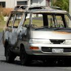The burnt out shell of a van which was set alight at Luke St, Ocean Grove, early yesterday. Photo...