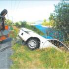 The car belonging to Dunedin chef Richard Bilsborough is dragged from the Grey River. Photo by...