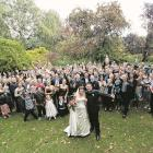 The celebratory gathering of guests at the wedding of Sarah Davie and Petros Nitis at the