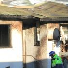 The  Clinton house damaged by fire yesterday morning. Photo: Hamish MacLean