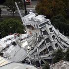 The collapsed Pyne Gould Corporation building in Christchurch. Photo by <i>The New Zealand Herald...