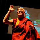The Dalai Lama acknowledges a standing ovation at the start of his Dunedin Town Hall talk. Photo...