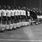The England, right, and West Germany football teams line up before the start of the World Cup...