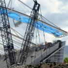 The final Forsyth Barrr Stadium Truss is lifted into place. Photo by Peter McIntosh.