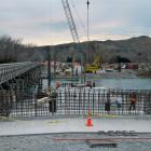 The first of the two new bridges being built over the Waitaki River begins to take shape this...