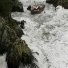 The fishing trawler 'San Cuvier' is battered by a huge swell where it was washed on to rocks near...