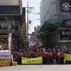 The Jeon family and their neighbours hold one of many protests in the hope local or national...