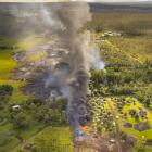 The June 27th lava flow from the Kilauea Volcano moves along he ground in Pahoa, Hawaii. Photo by...