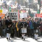 """The """"Keep Our Assets"""" protest moves along George St, Dunedin, on Saturday. Photo by Craig Baxter."""