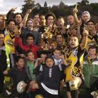 The Kia Toa Tigers celebrate winning the Dunedin competition on Saturday at the Oval.