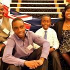 The Munyuku family (from left) Robson, Tatenda, Tinashe and Ndanatseyi, of Zimbabwe, embrace...