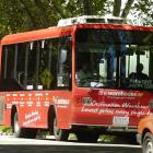 The new city loop bus resplendent in red with the route's stops marked along the side. Photo by...