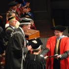 The next University of Otago chancellor, John Ward, caps current chancellor Lindsay Brown with an...