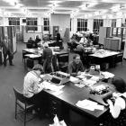The 'Otago Daily Times' newsroom in 1977. Included are cartoonist Sid Scales (left, with...