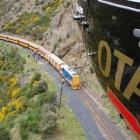 The Otago Regional Rescue Helicopter flies above a Taieri Gorge Railway train on Saturday.