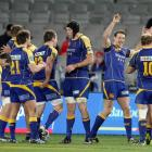 The Otago team celebrates after beating Auckland 32-25 last night.