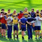 The Otago team stands in a huddle at Forsyth Barr Stadium earlier this week. Photo by Craig Baxter.