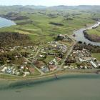 The Owaka River (right) reaches the Pacific Ocean near Pounawea. Catlins Lake is at top left....