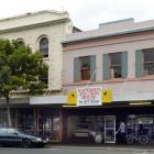 The protected building at 386 Princes St (behind tree), in Dunedin, has been declared unsafe by...