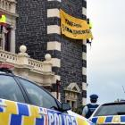 The protest banner three climbers unfurled  on behalf of  Greenpeace and Oil Free Otago on...