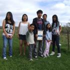The Quijano family with TrustPower Youth award winner Ray (centre) and (from left) Joy (16) Hope...