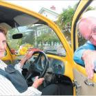 The Reverend Michael Kerr and his wife Ros inspect their fully refurbished 1964 Volkswagen Beetle...
