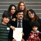 The Sarkhosh family from Iran, are (clockwise from bottom right) Parsa Sarkhosh, Abbas Sarkhosh, ...