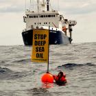 The seismic survey vessel <i>Orient Explorer</i> bears down on Greenpeace protester Kylee Mathews...