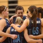 The St Hildas Collegiate School team goes into a huddle during the South Island secondary schools...