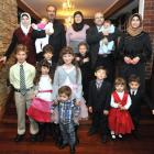 The Taha family, from Syria, are (top row, from left) Lina, Heba (8 weeks) Mouhannod, Izdehar,...