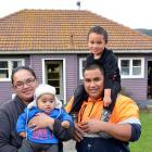 The Vahua family outside their Sunnyvale home, (from left) Sara, Hamuera (7 months), Io and Kepha...