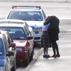 The victim of a stranger's unwanted attention is comforted after the incident in Dunedin...