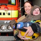 The Waikouaiti fire brigade wants to offer babysitting for its firefighters, like Katrina Hurst,...