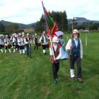 The Waitati Militia is pictured leading  a march past. Photo by Bill Campbell.