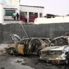 The wreckage of destroyed cars is seen at the scene of an explosion in Waabari district of...