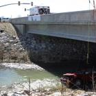 The wreckage of the car that Lily Groesbeck was saved from sits on an embankment underneath a...