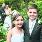 The young attendants, who are the bride's niece and nephew, at the wedding of Michaela...