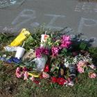 These flowers and messages were left on the footpath in Exe St, after the stabbing of Oamaru...