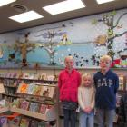 This mural of Oamaru birds which (from left) Chloe (10), Zara (5) and Harry (11) Wilson and...