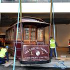 This painstakingly restored electric tram is moved back to the Otago Settlers Museum yesterday....